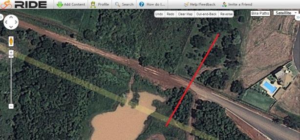 Asphalt road into earth track...